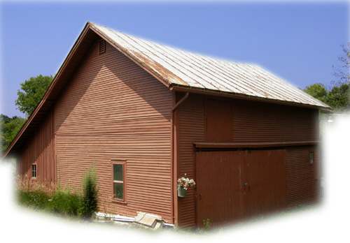 630 x 40' Clapboard Barn including west extension for storage or parking.